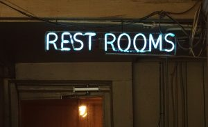 cropped-neon-restroom-sign